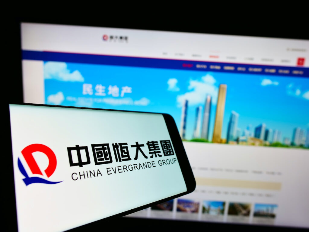 STUTTGART, GERMANY - Jun 21, 2021: Mobile phone with logo of Chinese property company Evergrande Real Estate Group on screen in front of website. Focus on center-left of phone display.
